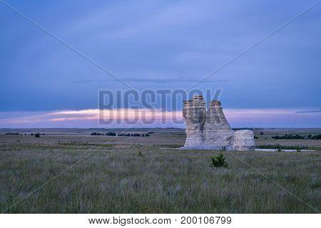 Castle Rock at dusk - limestone pillar landmark in prairie of western Kansas near Quinter (Gove County), late summer