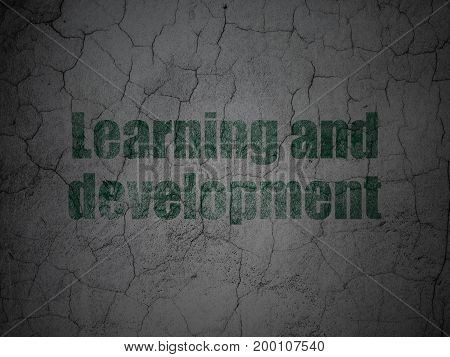 Education concept: Green Learning And Development on grunge textured concrete wall background