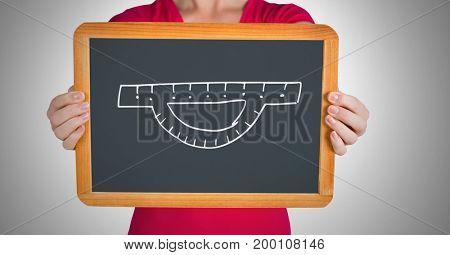Digital composite of Measurement ruler on blackboard