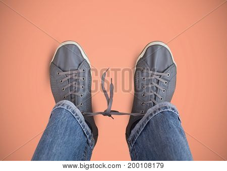 Digital composite of Grey shoes on feet with pink background