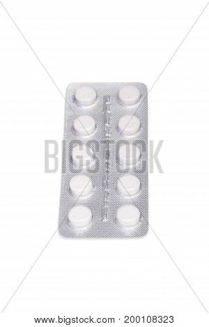 Close-up healthful vitamins in light gray blisters isolated on a white background. Top view of a single packaging of medicaments: antibiotics, painkillers, drugs, aspirin in white round tablets.