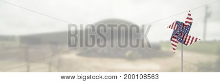Digital composite of USA wind catcher in front of farm land