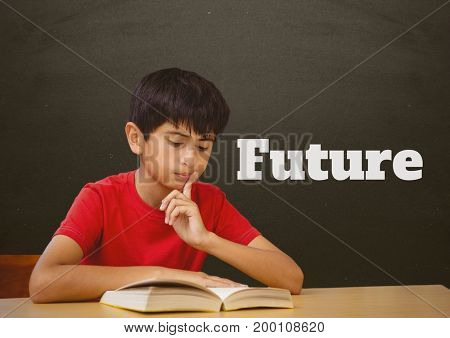 Digital composite of Student boy at table reading against grey blackboard with future text