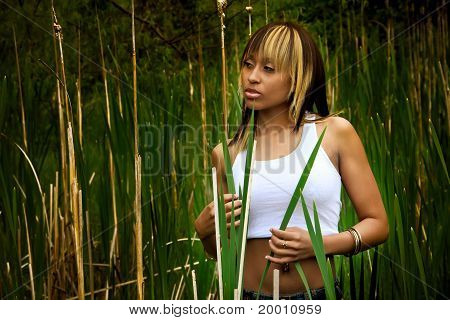 Beautiful Female In Tall Grass