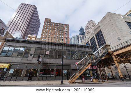 Chicago - March 2017, IL, USA: View of skyscrapers office buildings (Chicago Board of Trade) and enter to the metro station in downtown Chicago.