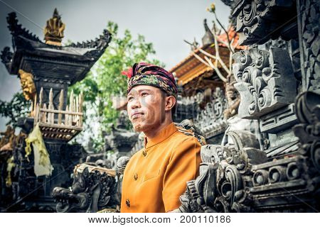 Close Up Portrait Of Balinese Indonesian Man Posing At The Tradtional Temple. Tropical Bali Island,