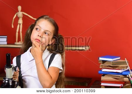 Back To School And Experiment Concept. Schoolgirl With Thoughtful Face