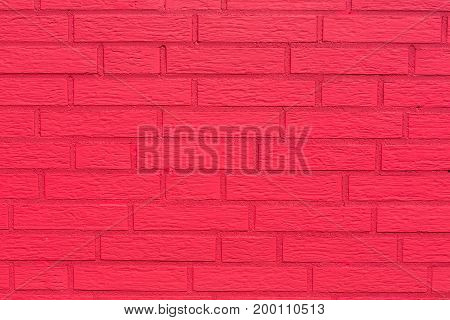 Brick background with red textured bricks. Colored red