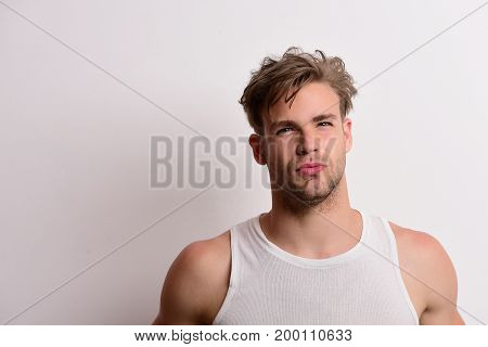 Athlete In White Sleeveless Shirt. Guy With Unshaved Face