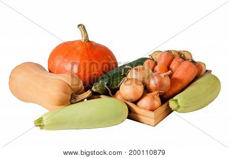 Fresh vegetables on wooden tray isolated on white background