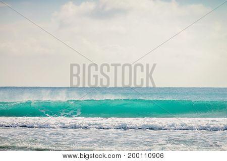 Blue wave in tropical ocean. Clear wave in tropics