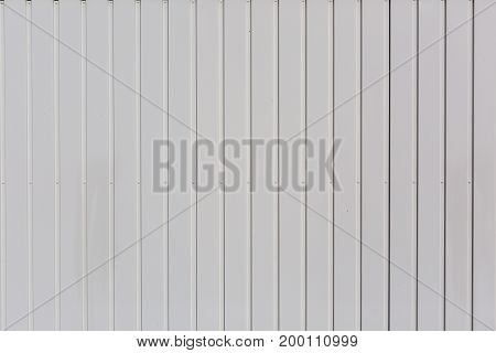 Background fence with vertically aligned wooden boards white