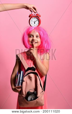 Pupil In School Uniform With Wig And Alarm On Head