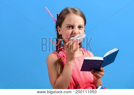 School Girl With Angry Face Isolated On Blue Background