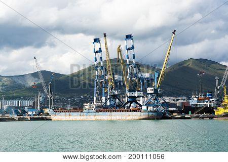 Novorossiysk, Russia - July 07, 2017: Barge in the Black Sea port near the loading cranes in the Russian city of Novorossiysk