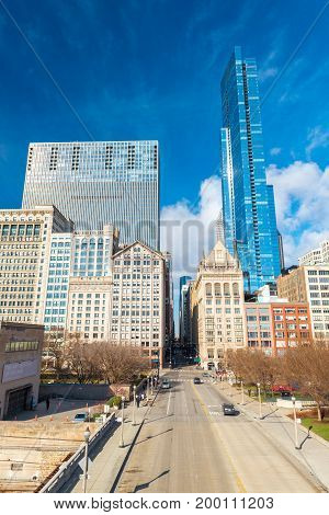 Chicago - March 2017, IL, USA: Skyscrapers and office buildings in downtown Chicago, view from Nichols Bridgeway near Millennium Park