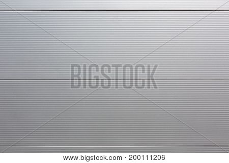 Textured metal background shiny silver. Modern structure