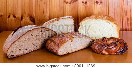Assortment of baked bread on wooden table. Selective focus
