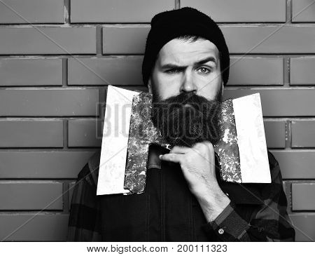 Bearded Worker Man Holding Spatulas With Serious Face
