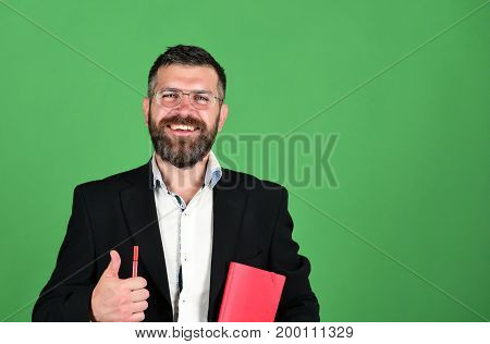 Teacher Wears Glasses, Holds Pen And Shows Thumbs Up