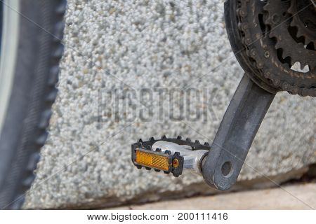 Bicycle pedals and sprockets on blurred background