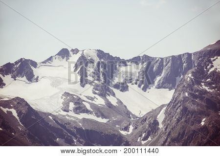 Snow Covered Mountains And Rocky Peaks