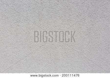 Background white wall with textured pattern. coarse structure: