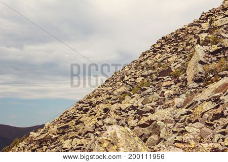 Stone Deposits On The Slopes Of A Steep Mountain.