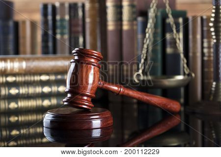 Law symbols. Lawyer theme. Judge wooden gavel and scale of justice.