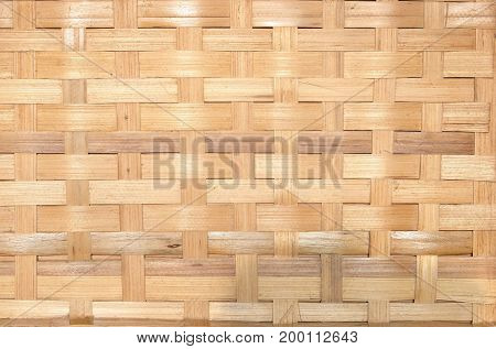 Striped background of sandy brown wicker straw front view closeup