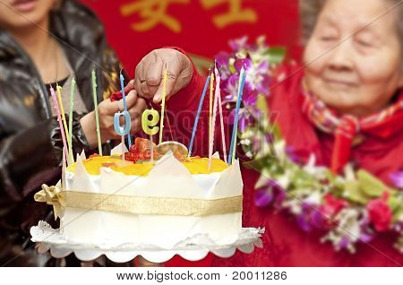 90 years old woman on her birthday party