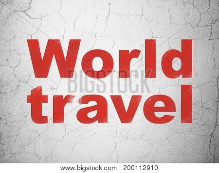 Travel concept: Red World Travel on textured concrete wall background