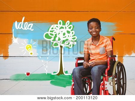 Digital composite of Disabled boy in wheelchair with idea colorful drawings