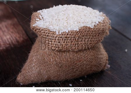 Photo image. Food photography. Raw uncooked white rice cereal grain background. Asian main carbohydrate source