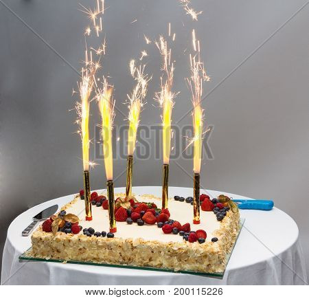Cake with candles for the jubilee evening