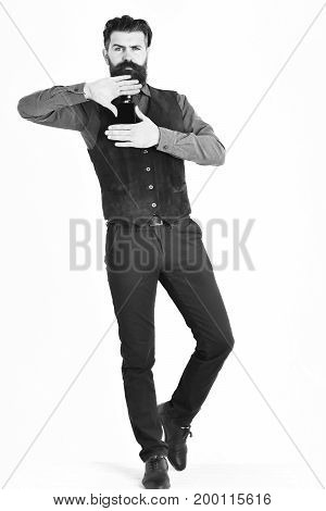 bearded man long beard brutal caucasian hipster with moustache holding perfume with serious face isolated on white background