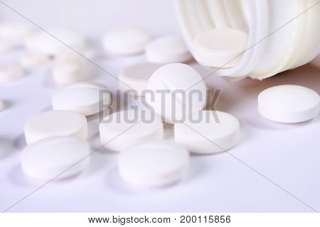 Variety of different tablets pills capsule heap mix therapy drugs pharmacy medical background