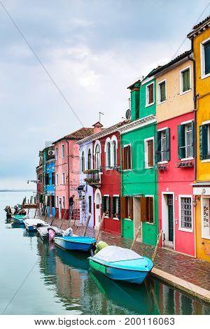 Burano Island, Venice, Italy - November 11, 2014: Venice landmark, Burano island, colorful houses and boats