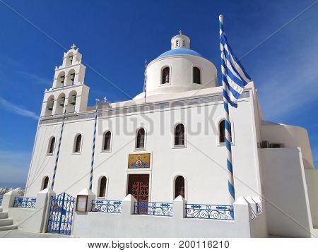 White Colored Church of Panagia of Platsani against Vivid Blue Sky at Oia Village of Santorini Island, Greece