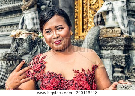 Close Up Portrait Of Traditionally Dressed Young Female Balinese Woman At The Temple. Bali, Indonesi