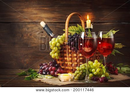 Happy Thanksgiving Day background, wooden table, decorated with fruits and a bottle of wine. Autumn harvest festival.