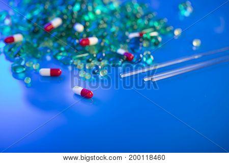 Pharmacy industry theme. Set of different pills. Bokeh.