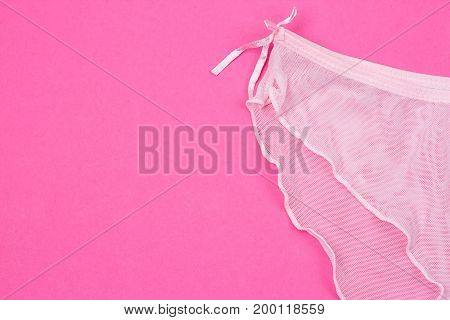 Women's cotton panties on pink background. Pink underwear.