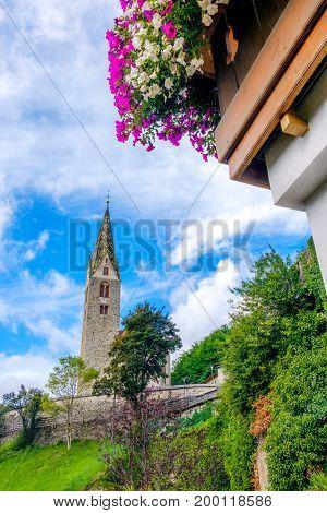Villandro (Villander) - Trentino Alto Adige - Sudtirolo - Italy - bell tower flowers on balcony