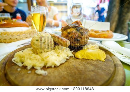 south tyrol food pork shank beer canederli kraut sausage