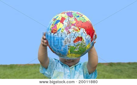 boy holding the earth model