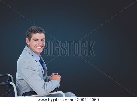 Digital composite of Disabled man in wheelchair with dark background