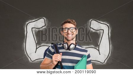 Digital composite of Happy student man with fists graphic standing against grey blackboard