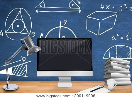 Digital composite of Computer Desk foreground with blackboard graphics of mathematical diagrams