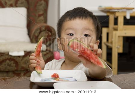 baby eating watermelon